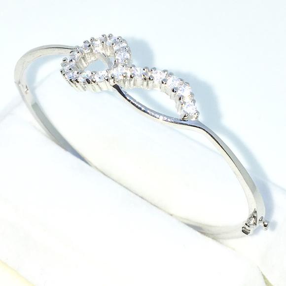 a048389bd6a Silver Oval Bangle Bracelet 4 prong White round CZ. Boutique. 3 Royal Dazzy